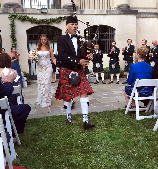Bagpiper Paul Cora piping memorial music on his bagpipes at a Wedding at the Baltimore Museum of Art (BMA).